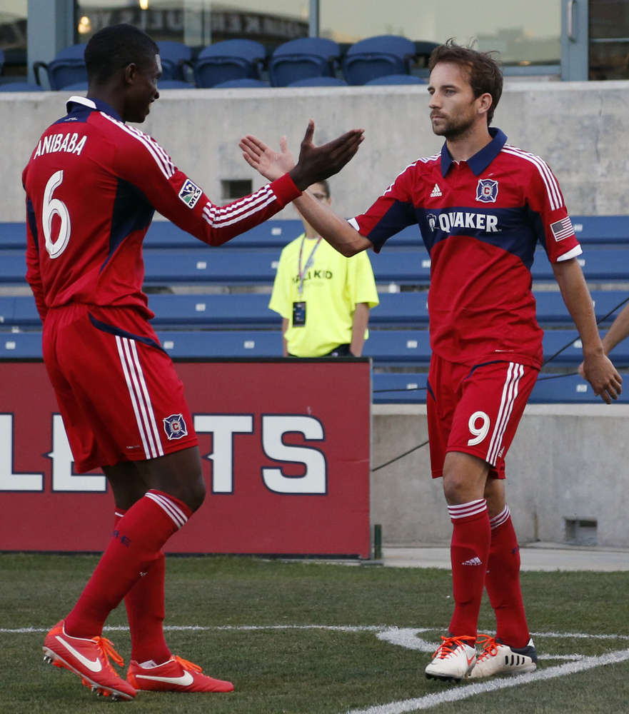 FILE - In this June 19, 2013, file photo, Chicago Fire midfielder Mike Magee, right, celebrates his penalty kick goal with de