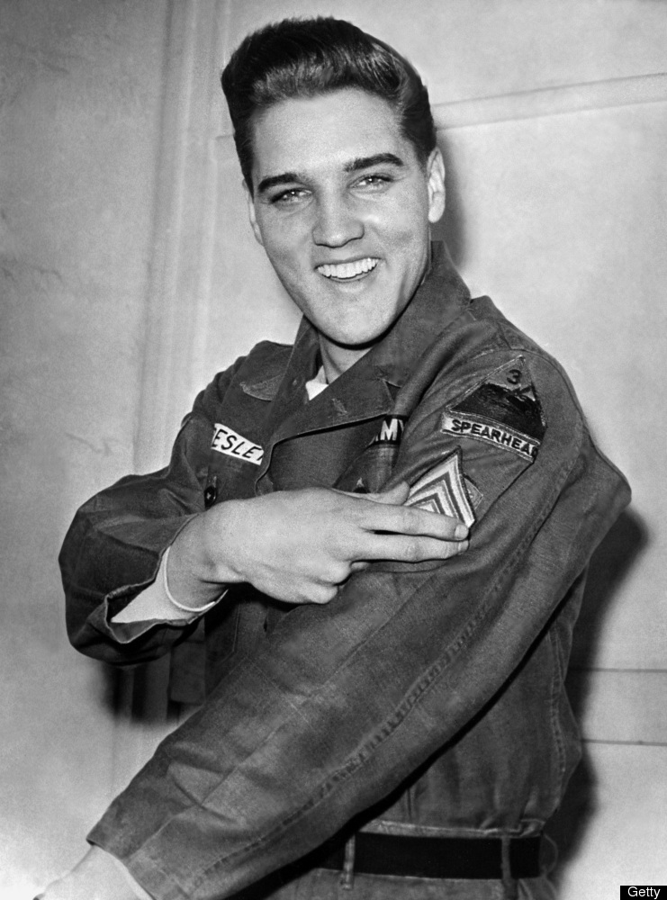 (FILES) Rock'n roll legend Elvis Presley shows his sergeant insignia on February 14, 1960 in Friedberg, Germany, during his m