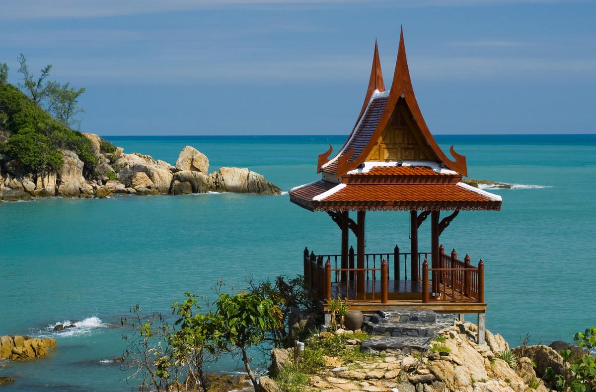 Thailand, Koh Samui, Choeng Mon Bay, samui peninsula resort, massage spa house with ornate roof overlooking the beach.