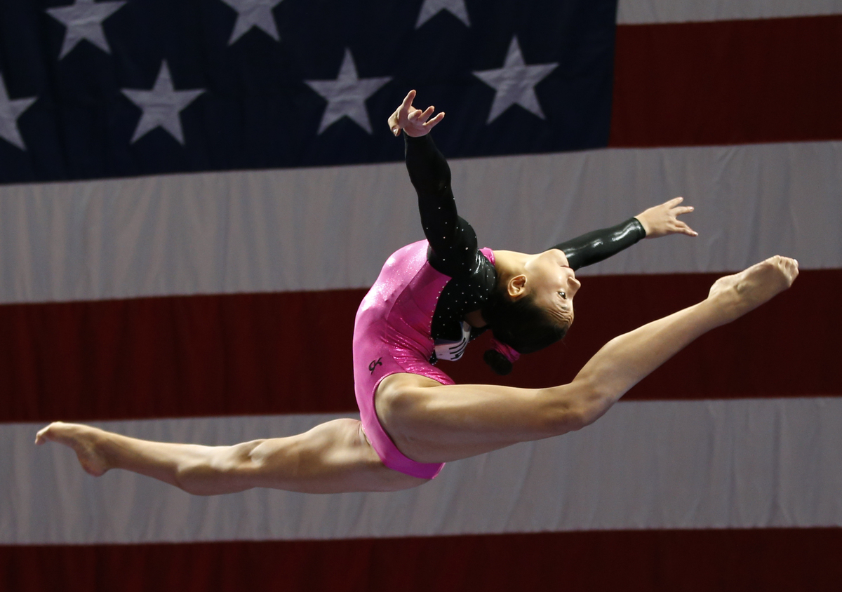Kyla Ross competes on the balance beam during the U.S. women's national gymnastics championships in Hartford, Conn. Thursday,