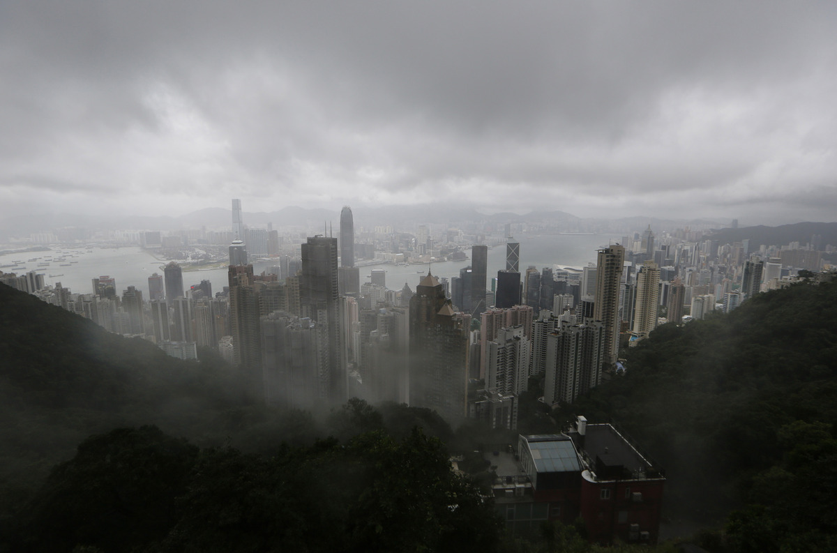 Clouds hang low over Hong Kong, seen from the Victoria Peak, on Tuesday, Aug. 13, 2013 as Typhoon Utor intensified slightly a