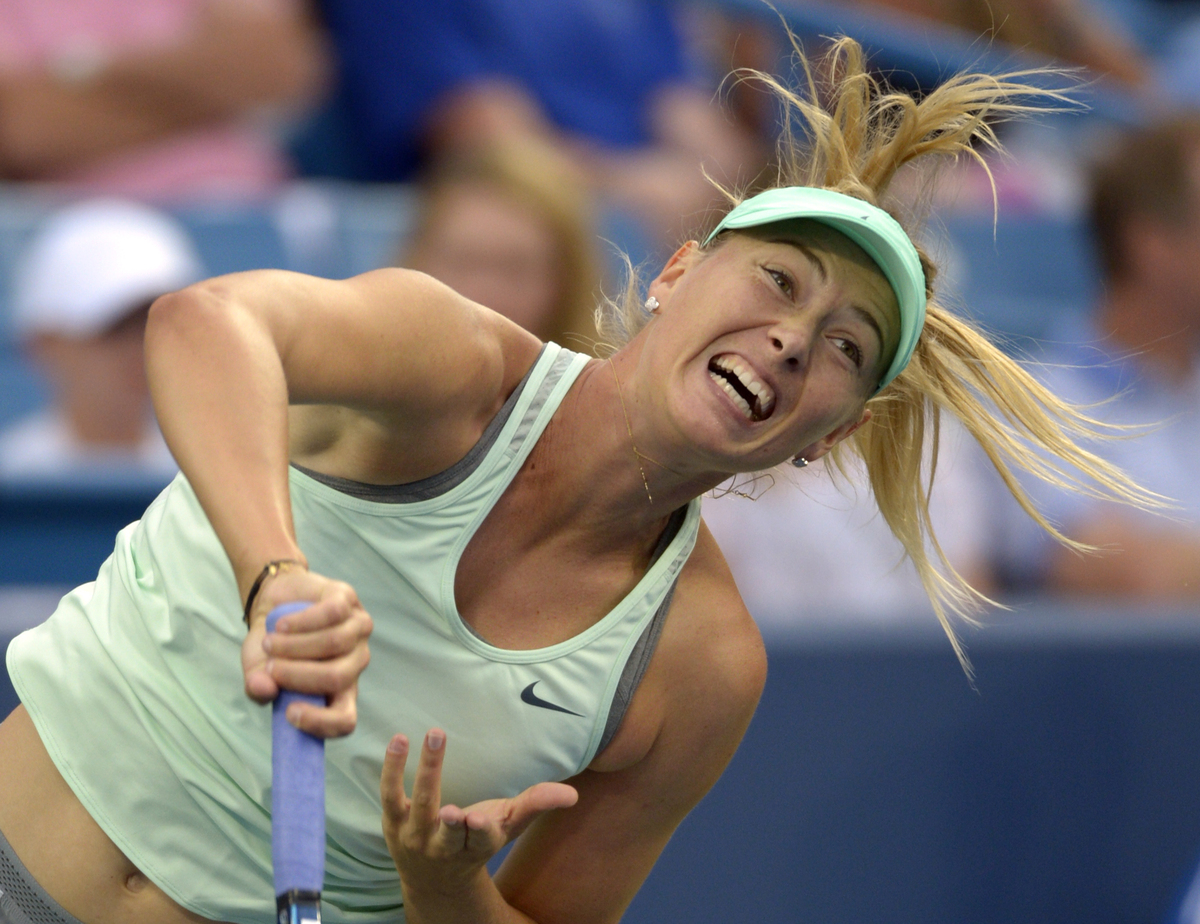 Maria Sharapova, from Russia, serves during a match against Sloane Stephens, from the United States, at the Western & Souther