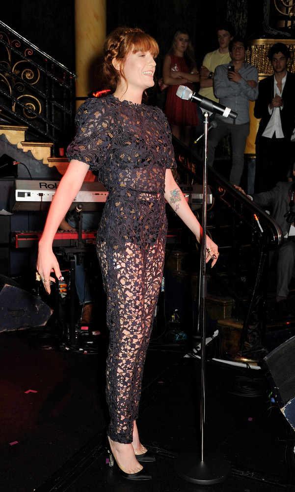 Florence Welch's lace onesie proves that just because you're wearing pants doesn't mean that you're fully covered. The singer