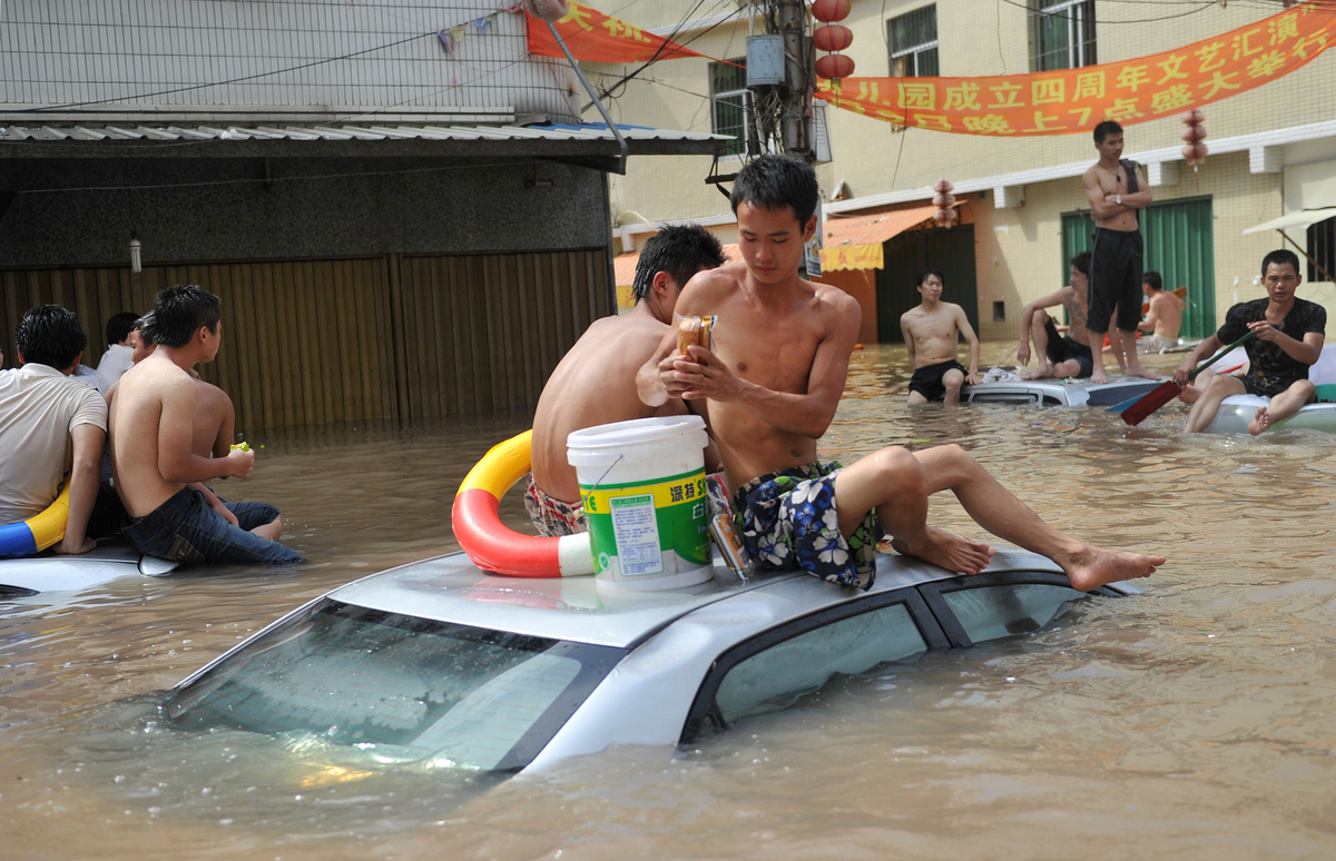 Heavy rains brought by Typhoon Utor triggered landslides and floods in southern China. More than 200 people have been reporte