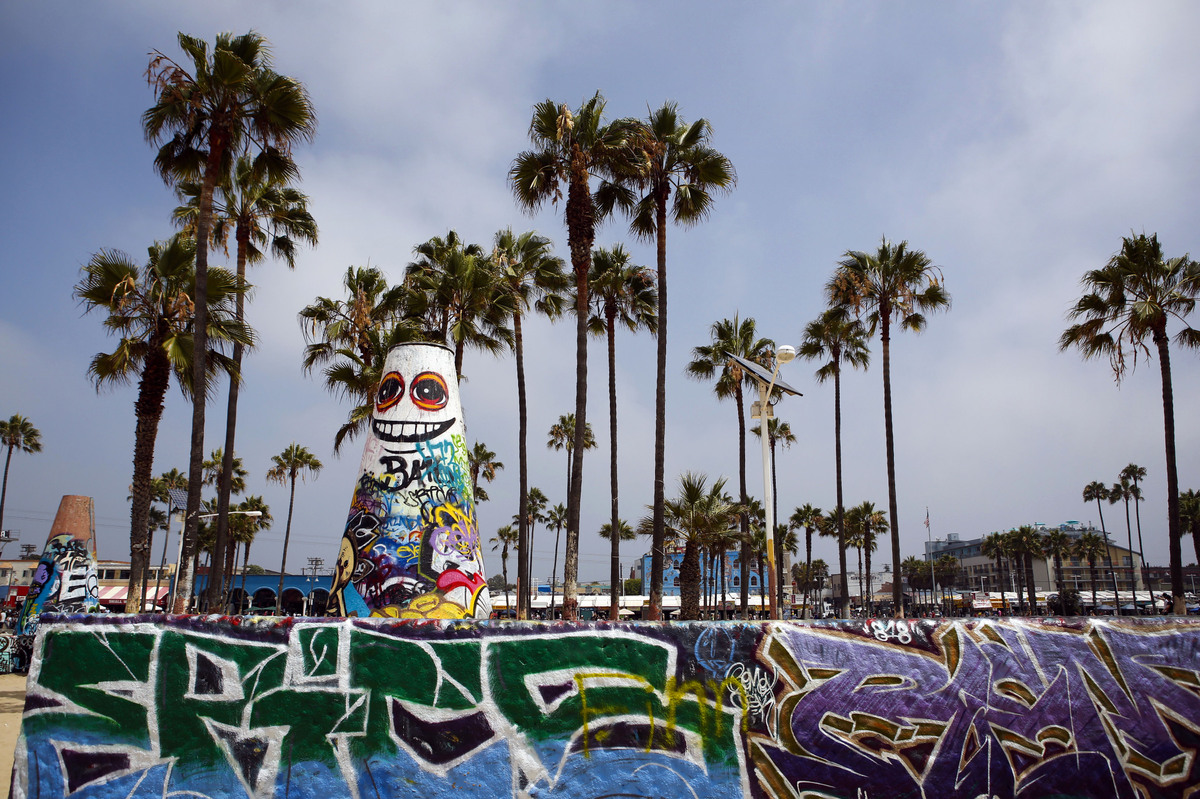 Graffiti is displayed on the paint wall at Venice Beach in Los Angeles.  (Patrick T. Fallon/Bloomberg via Getty Images_