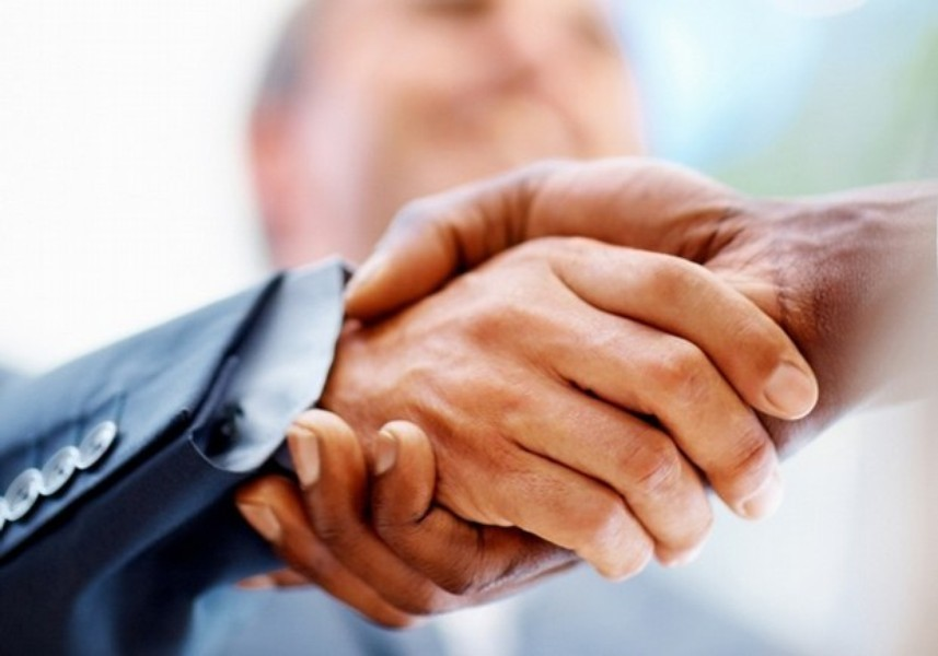 """Before you shake hands, rise, walk up to the hiring manager with confidence, make eye contact and smile. """"Make sure your hand"""