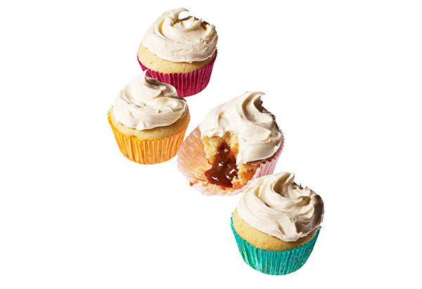 Instead of jazzing up a basic vanilla cupcake with frosting or filling, this outrageous recipe has you swirling caramel sauce