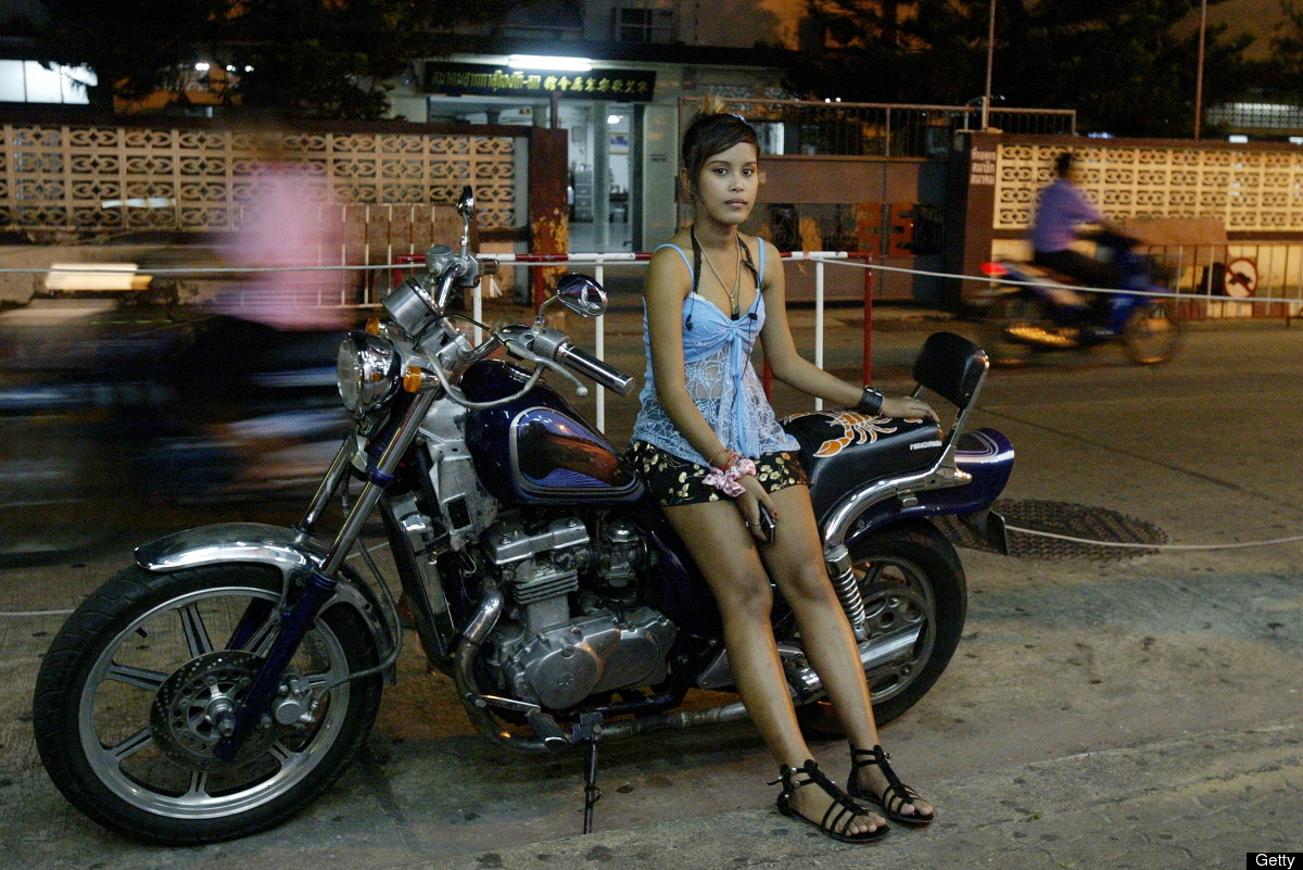 On Aug. 18, 2009, a bar girl waits for customers outside a bar in Sungai Kolok in Thailand's southern province of Narathiwat.