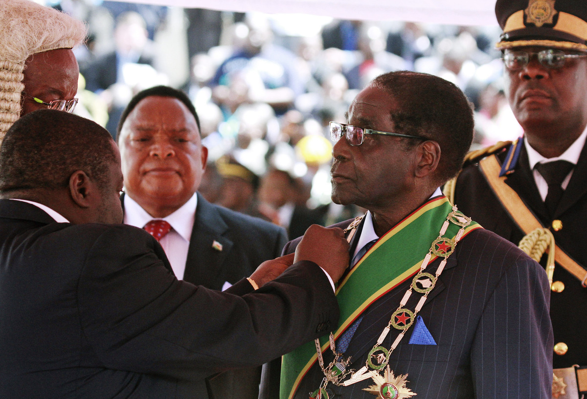 Zimbabwean President Robert Mugabe is inaugurated in Harare, Thursday, Aug. 22, 2013. (AP Photo/Tsvangirayi Mukwazhi)