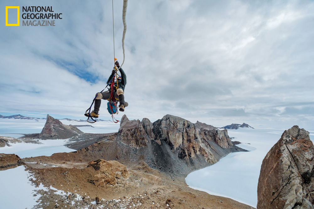 Suspended from an anchor in the rock hundreds of feet above the ice and snow, Mike Libecki hauls himself up a granite tower i