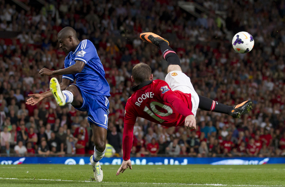 Manchester United's Wayne Rooney, right, attempts a bicycle kick past Chelsea's Ramires during their English Premier League s