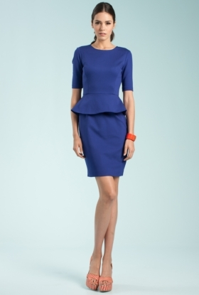 This cobalt blue peplum dress is so versatile! Wear it with colorful accessories for a fun daytime wedding or add glam metall