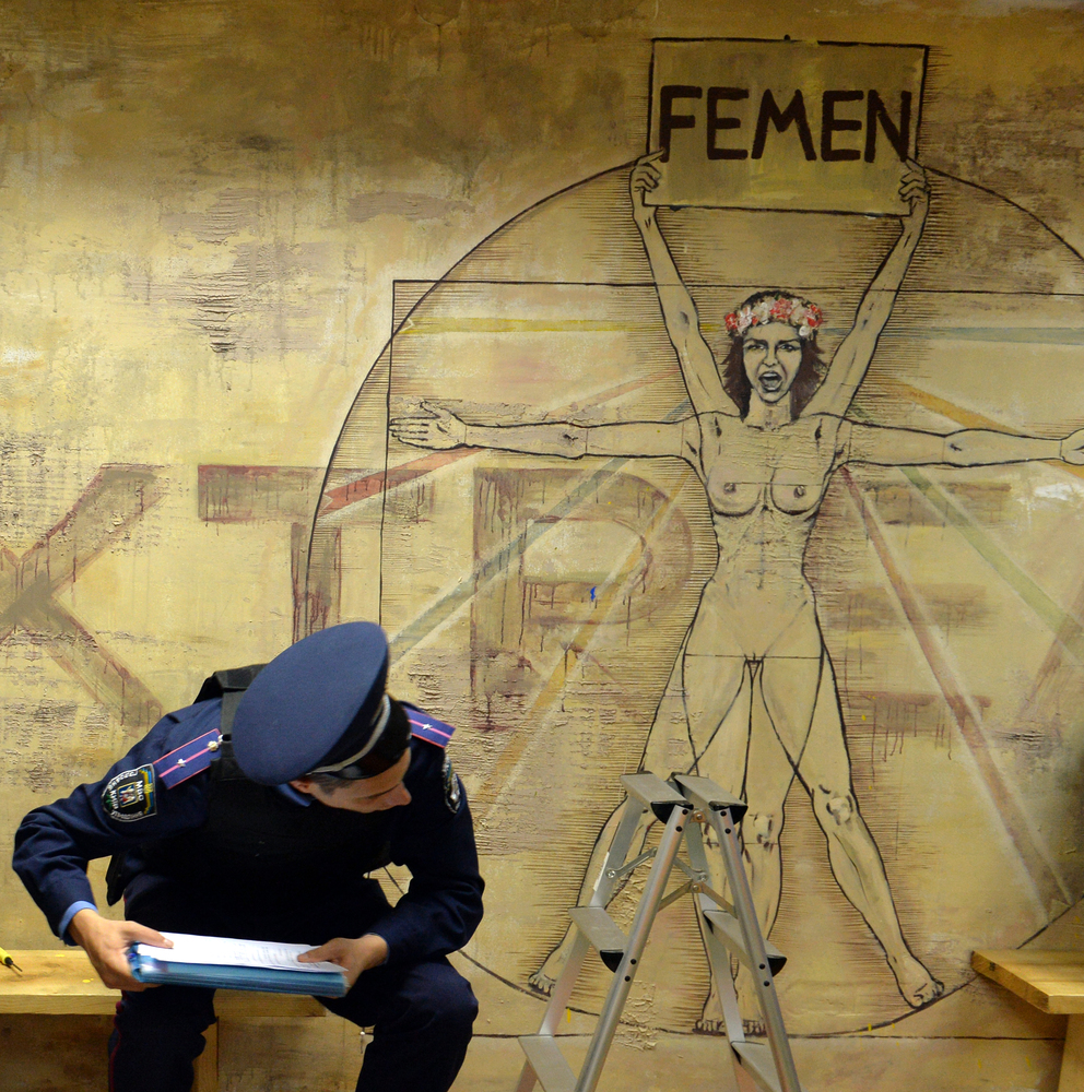 Ukrainian police search the premises of the Ukrainian feminist movement FEMEN in Kiev on August 27, 2013. (SERGEI SUPINSKY/AF