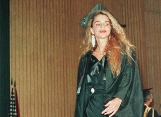 Receiving her degree from the American University in Cairo in 1991.