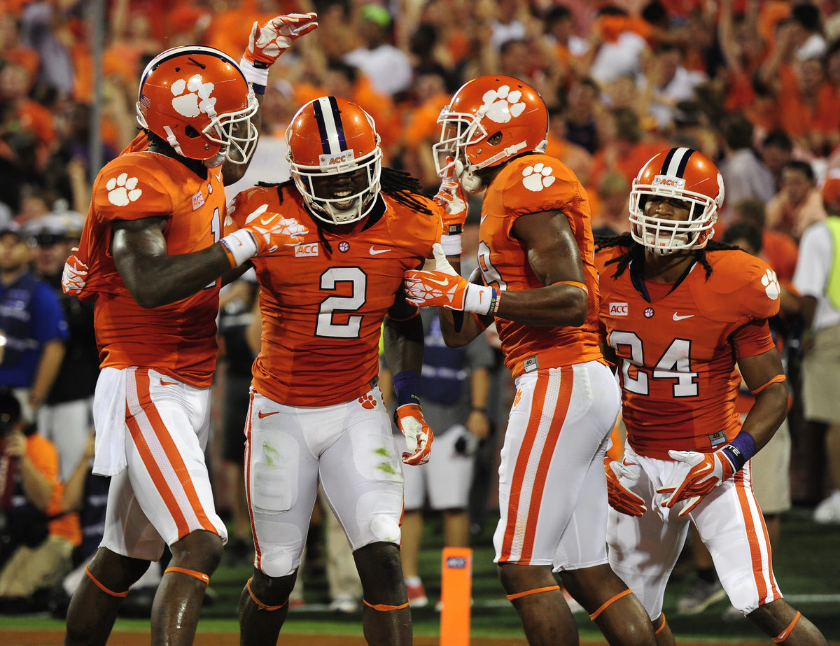 Clemson players Martavis Bryant, left, Charone Peake, and Zac Brooks congratulate Sammy Watkins (2) for a first quarter touch