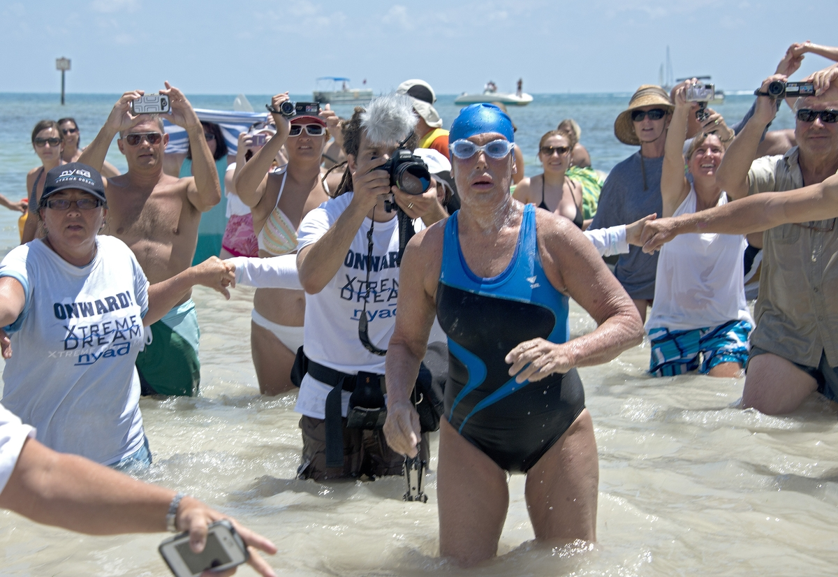 FILE - In this Monday, Sept. 2, 2013 file photo provided by the Florida Keys News Bureau, Diana Nyad emerges from the Atlanti