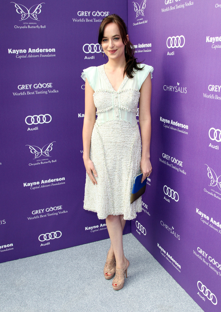 Actress Dakota Johnson arrives at the 12th Annual Chrysalis Butterfly Ball on June 8, 2013 in Los Angeles, California.  (Phot
