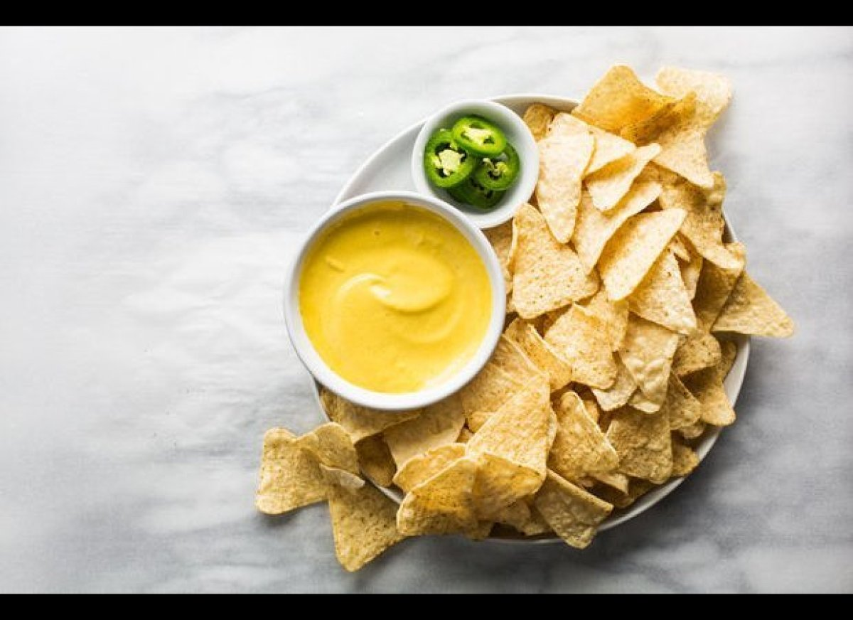 "<em><strong><a href=""http://food52.com/recipes/20517-nacho-cheese-sauce"" target=""_hplink"">Get the recipe on Food52</a></stron"
