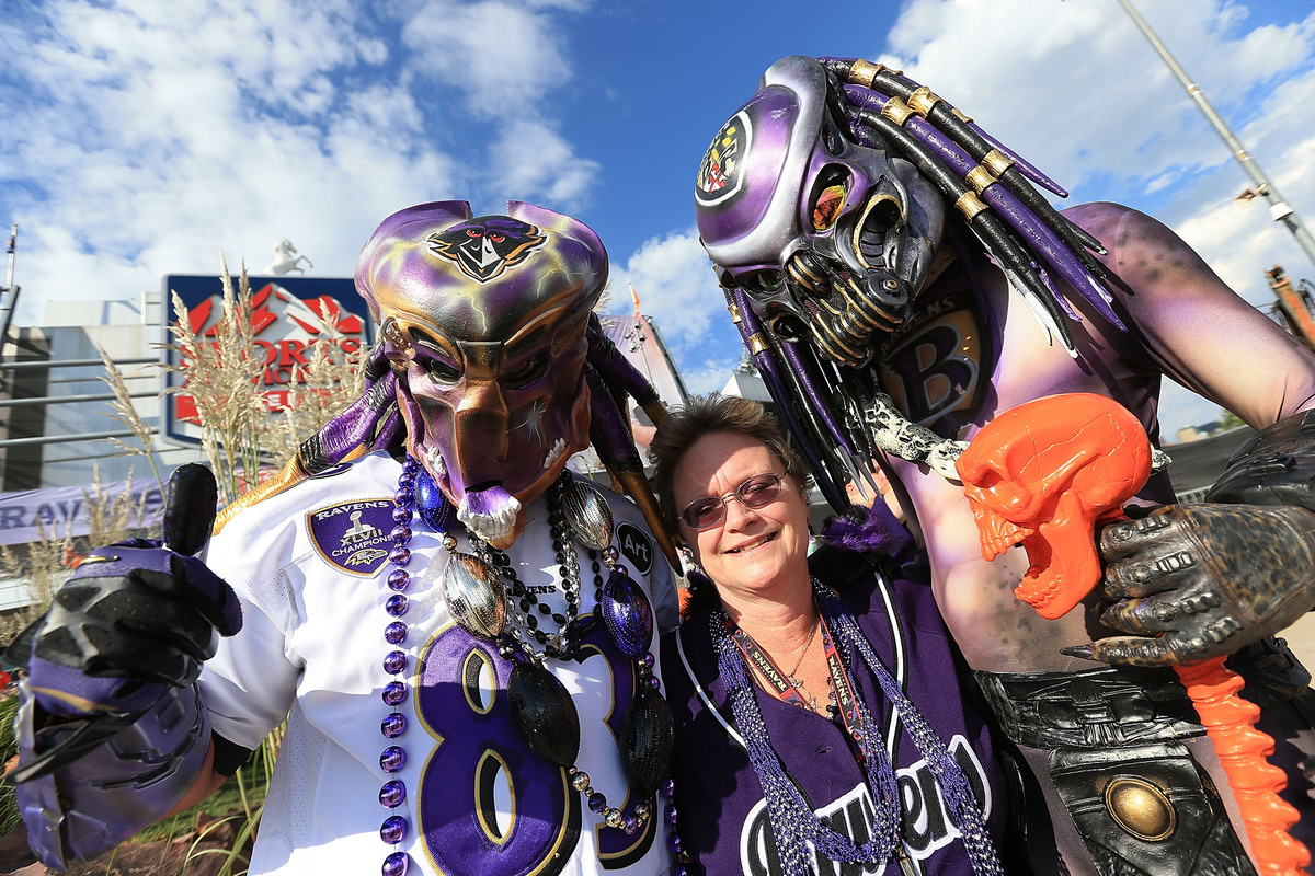 DENVER, CO - SEPTEMBER 5: Tonya McCormick of Towson, Maryland poses for a portrait with fellow Baltimore Ravens fans prior to