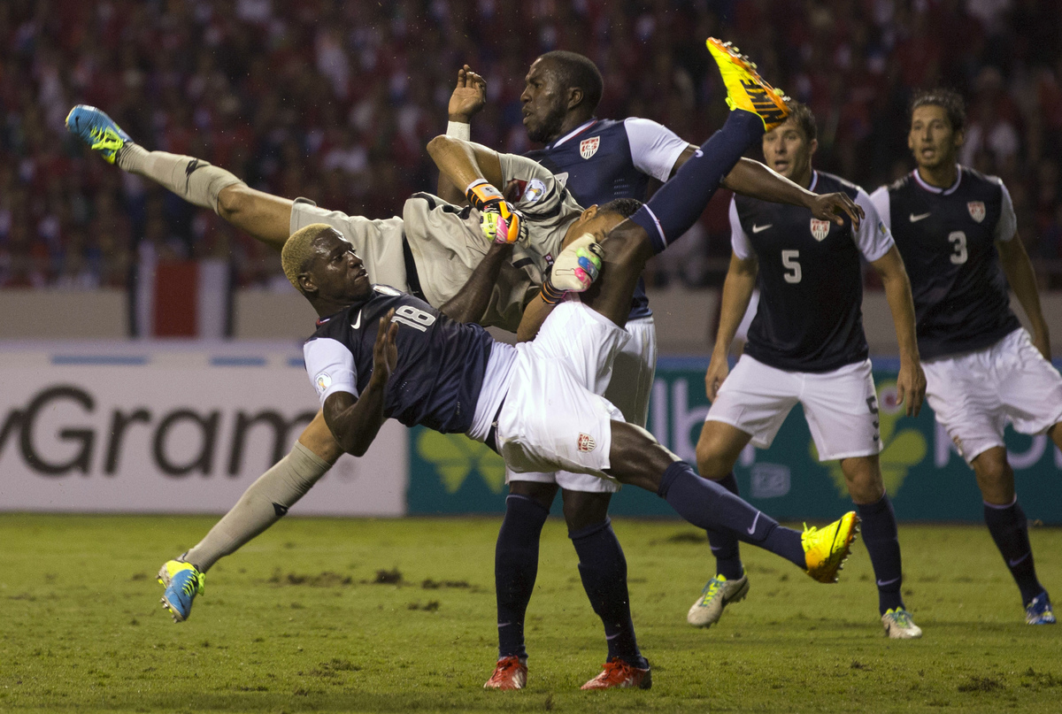 United States' Eddie Johnson, front, collides with Costa Rica's goalkeeper Keylor Navas who blocked his attempt to score duri