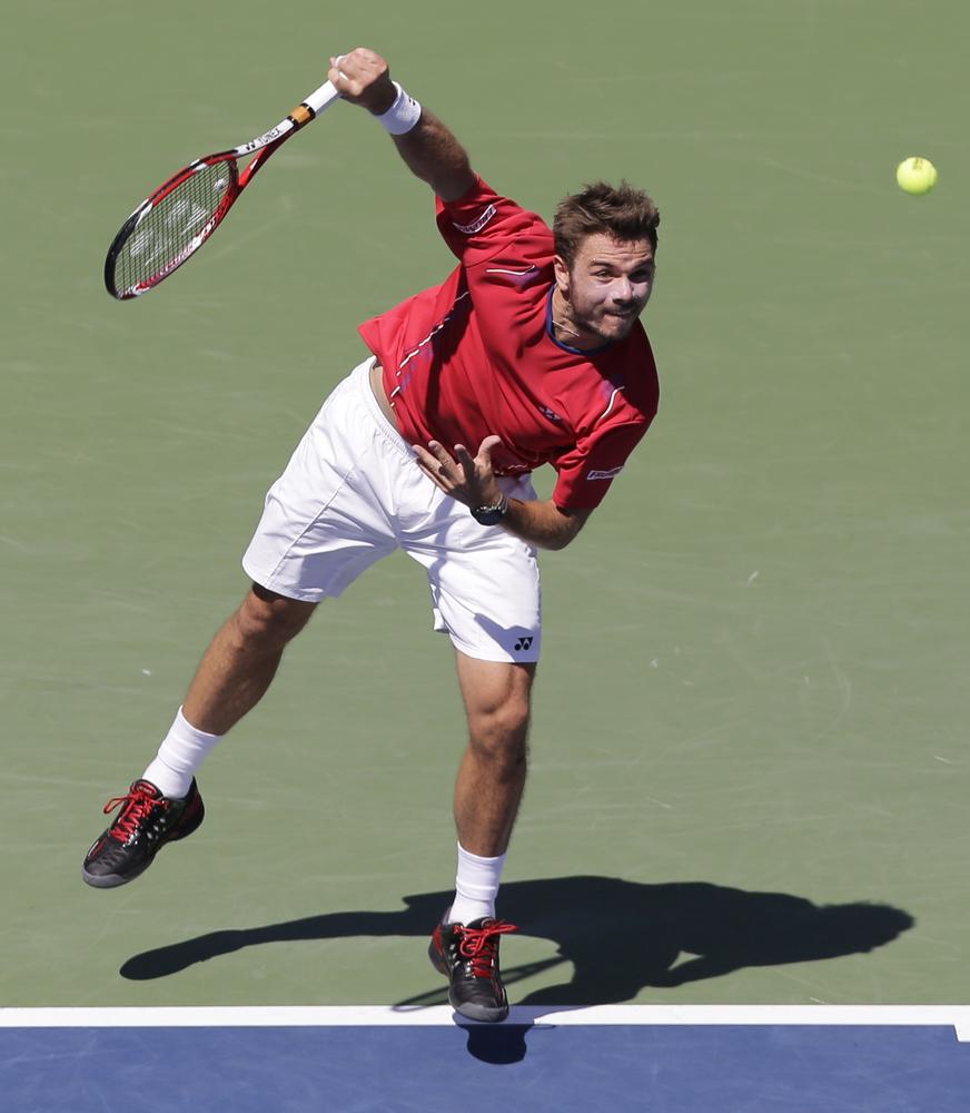 Stanislas Wawrinka, of Switzerland, serves against Novak Djokovic, of Serbia, during the semifinals of the 2013 U.S. Open ten