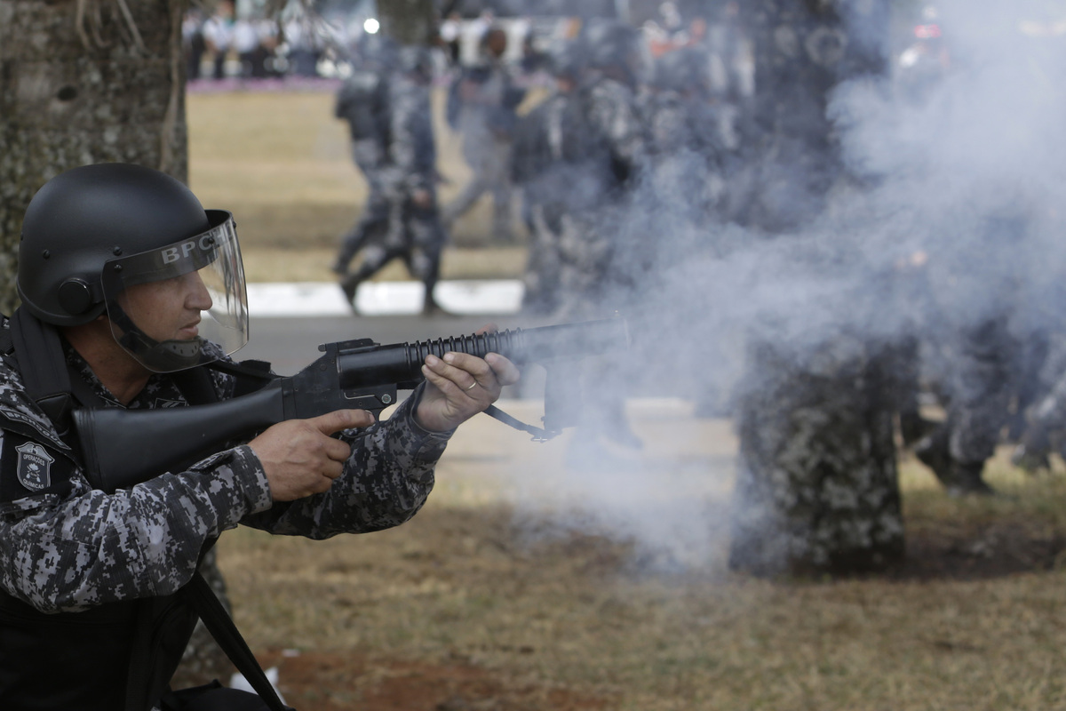 Military police fire tear gas at protesters after the military ceremony marking Independence Day in Brasilia, Brazil, Saturda