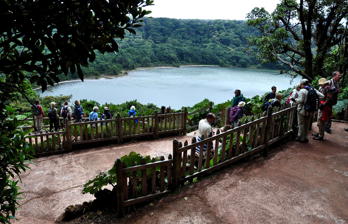 PHOTO: Tourists from different countries visit The Botos Lagoon at the Poas Volcano National Park in Alajuela, some 40 kilome