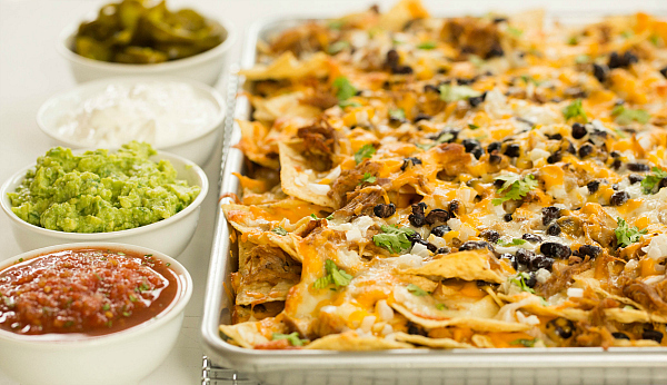 "<strong>Get the <a href=""http://www.browneyedbaker.com/2013/09/17/ultimate-nachos-with-beer-braised-carnitas/"" target=""_blank"