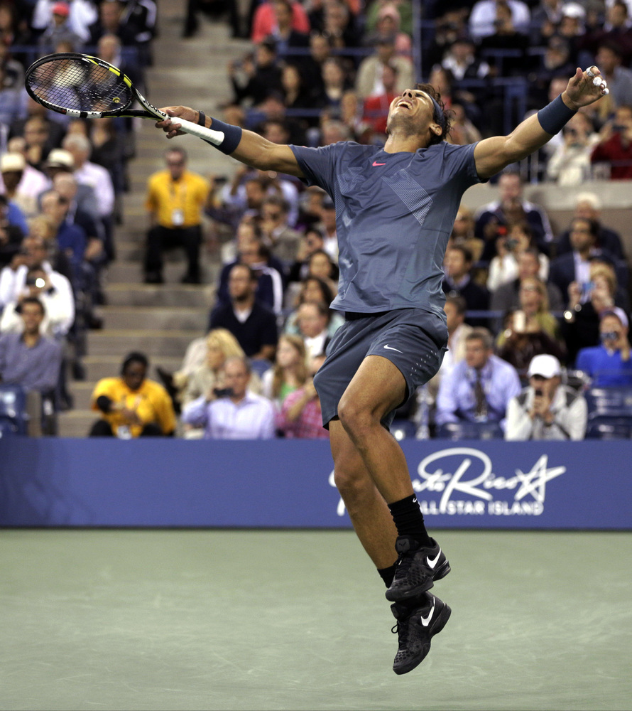 Rafael Nadal, of Spain, reacts after defeating Novak Djokovic, of Serbia, during the men's singles final of the 2013 U.S. Ope