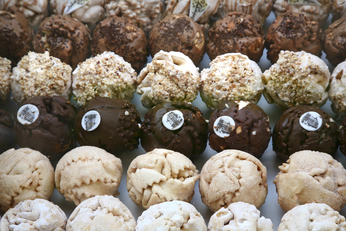 Shneeballen (or 'snowballs') is a German dessert made by cutting dough into strips, forming them into a ball, frying it, and