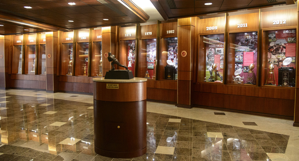 In this Aug. 28, 2013 photo, Alabama trophies from numerous championship years are displayed in the Hall of Champions at the