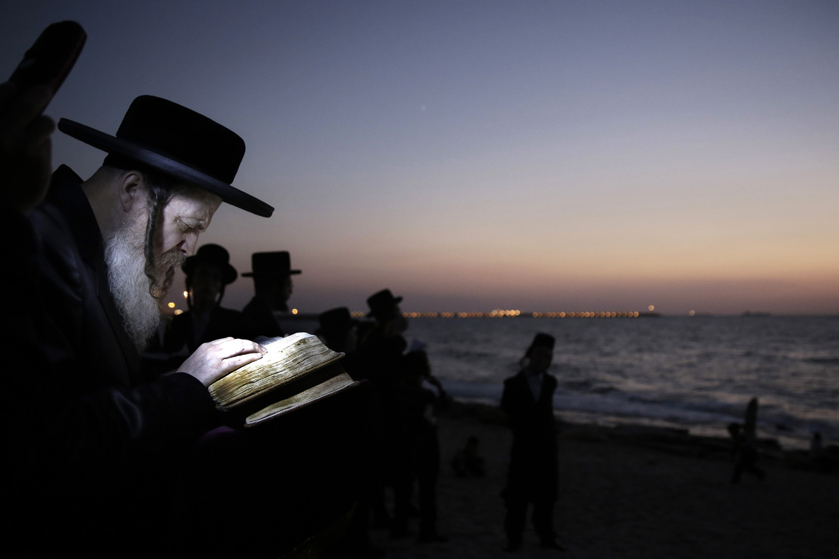 Ultra-Orthodox Jewish men participate in a Tashlich ceremony at the Mediterranean sea, in the southern Israeli port city of A