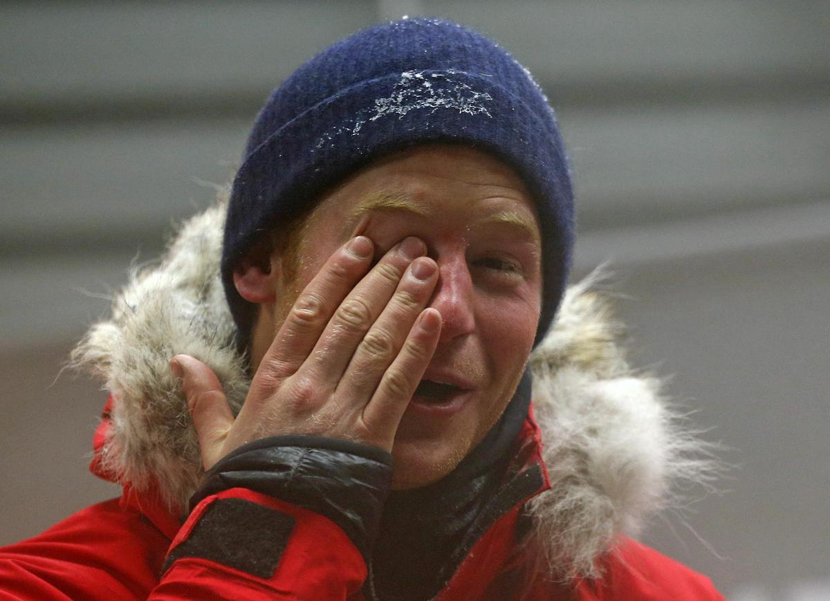 NUNEATON, ENGLAND - SEPTEMBER 17: Prince Harry rubs his eye after a cold chamber training exercise with the 'Walking with the