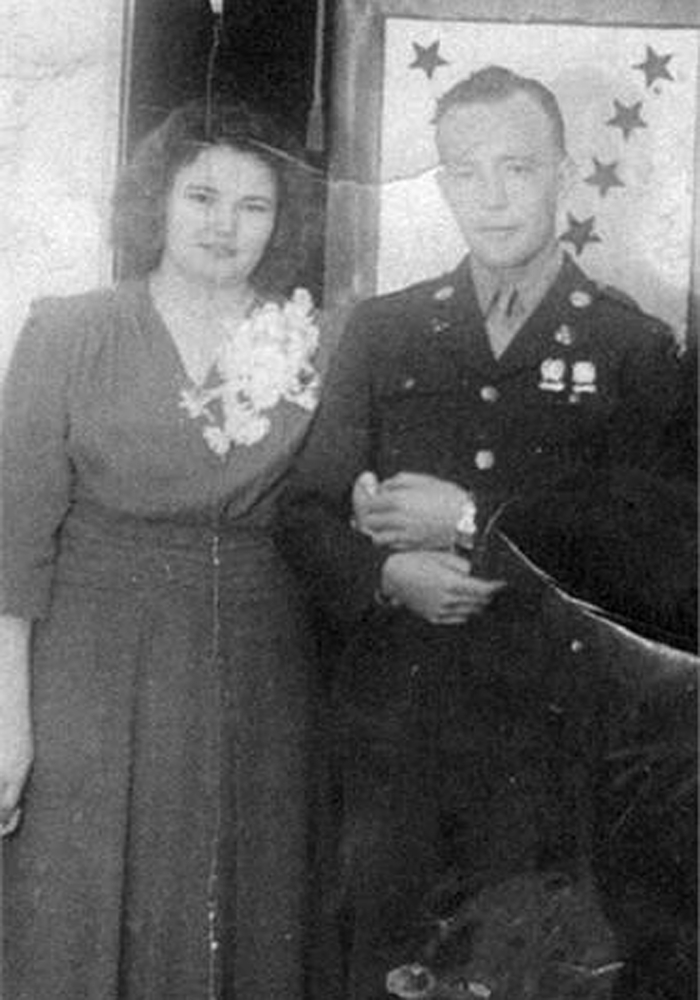 In this undated family photo provided by Kevin Smith is a wedding picture of Pfc. John Farrell Eddington and his wife, Helen.