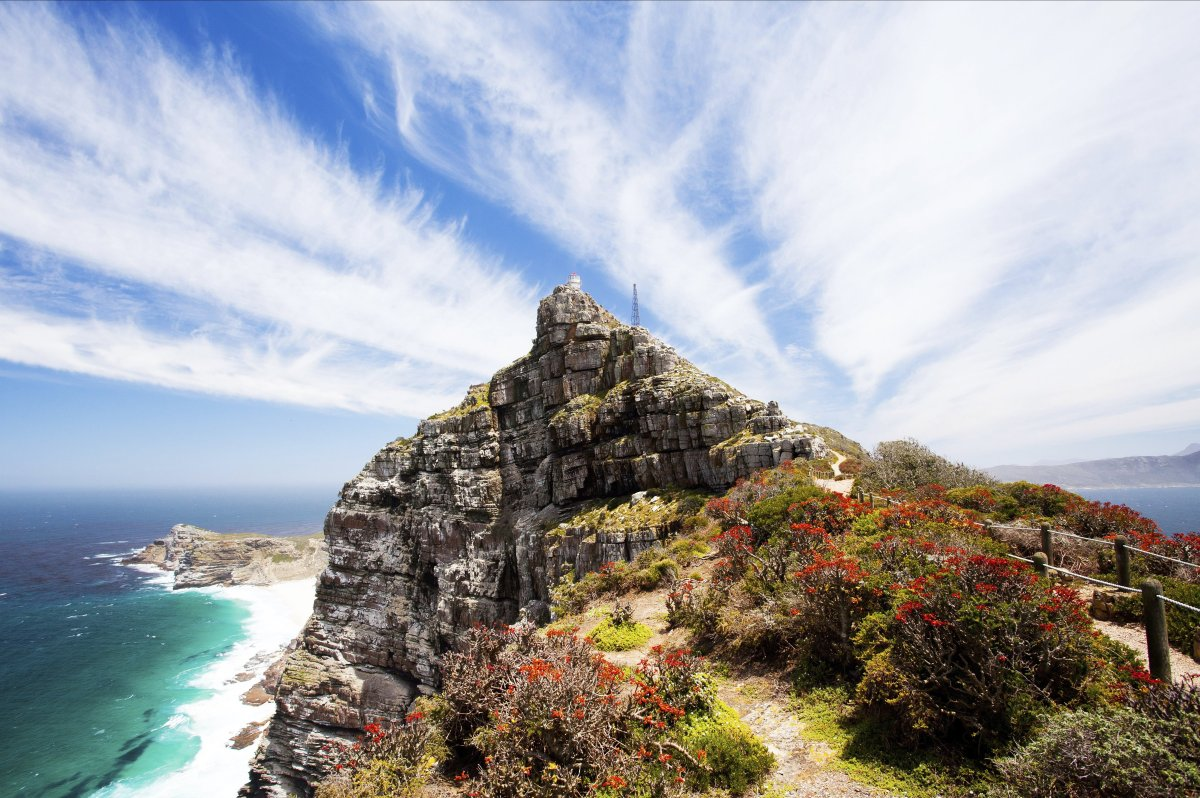 Nicknamed the Cape of Storms by Portuguese explorer Bartolomeu Dias, Cape Point's rugged rocks and steep cliffs tower over th