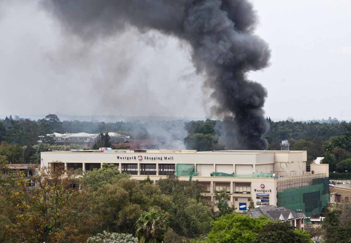 A plume of black smoke billows over the Westgate Mall, in Nairobi, Kenya Monday, Sept. 23, 2013. Multiple large blasts have r