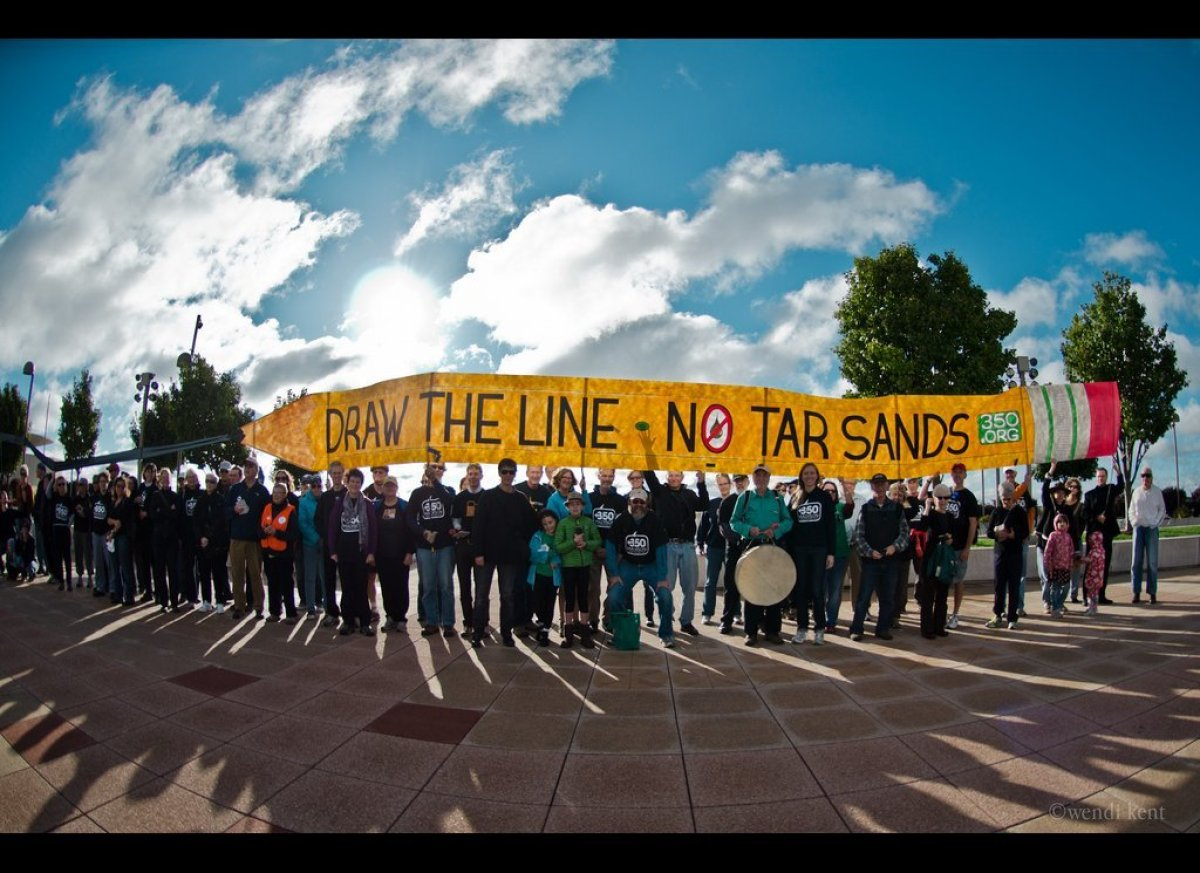Activists in Madison, WI have got a giant pencil for President Obama to draw a line against Keystone XL and reject the tar sa