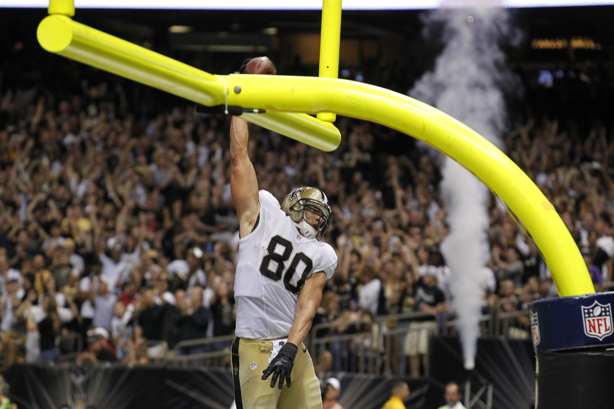 New Orleans Saints tight end Jimmy Graham (80) slam dunks over the goalpost after scoring on a touchdown reception in the sec