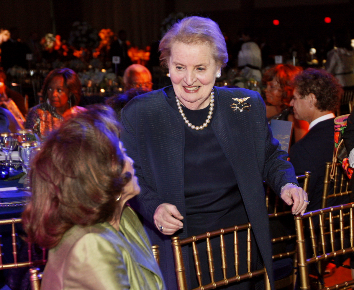Former Secretary of State Madeleine Albright greets a guest at her table during the Honoring Global Leaders for Peace interna