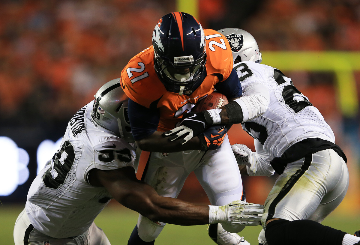 DENVER, CO - SEPTEMBER 23:  Ronnie Hillman #21 of the Denver Broncos rushes for a first down against the defense of  Lamarr H