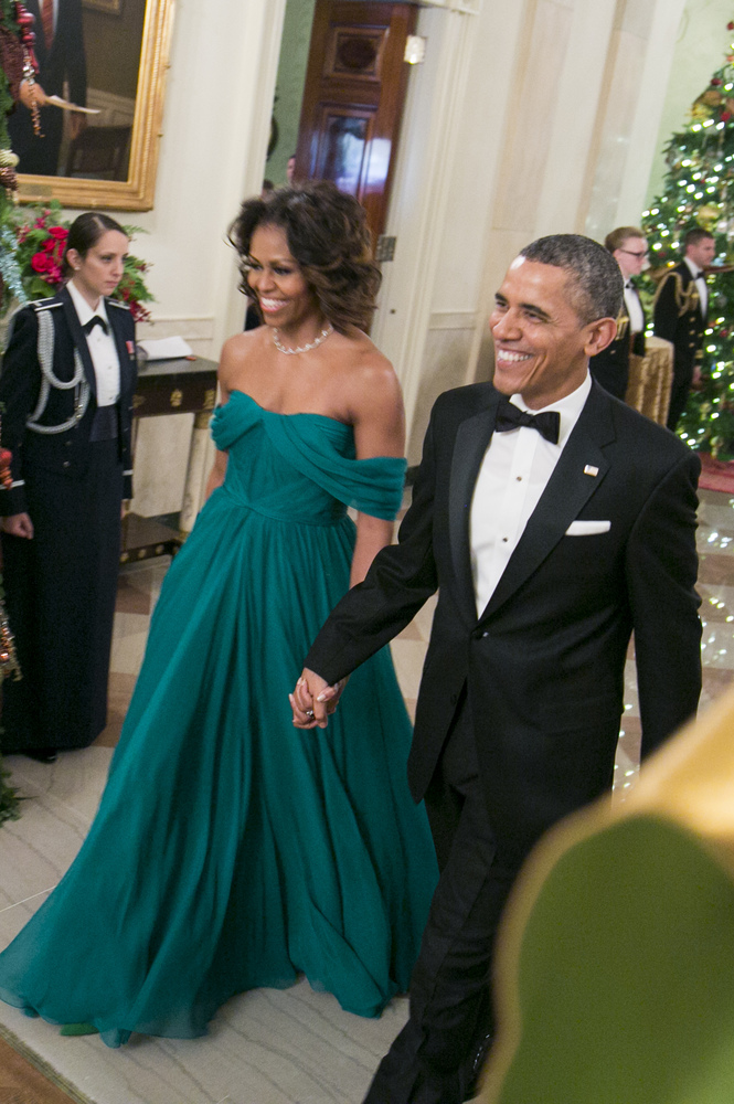 This dress left us awestruck. The emerald off-the-shoulder gown highlights her famous guns, while her delicate diamond neckla
