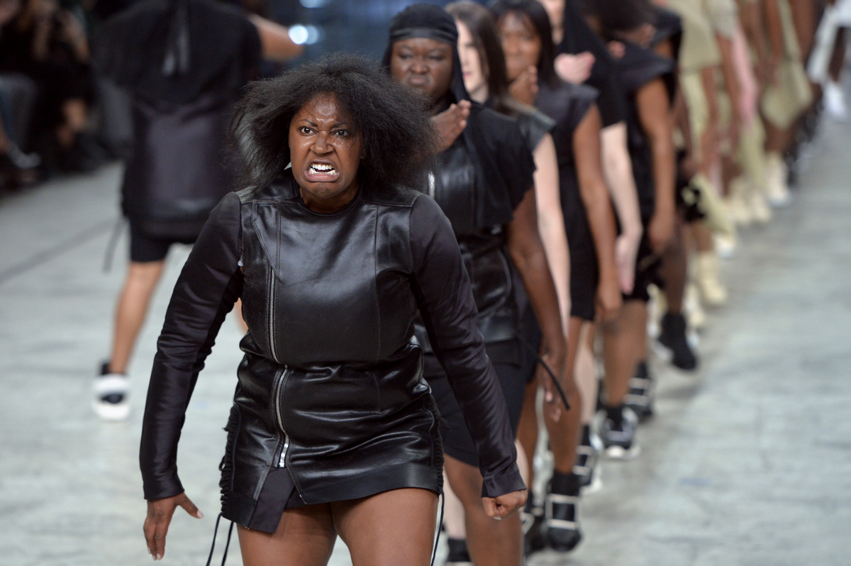 Models perform as they present creations by Rick Owens during the 2014 Spring/Summer ready-to-wear collection fashion show, o
