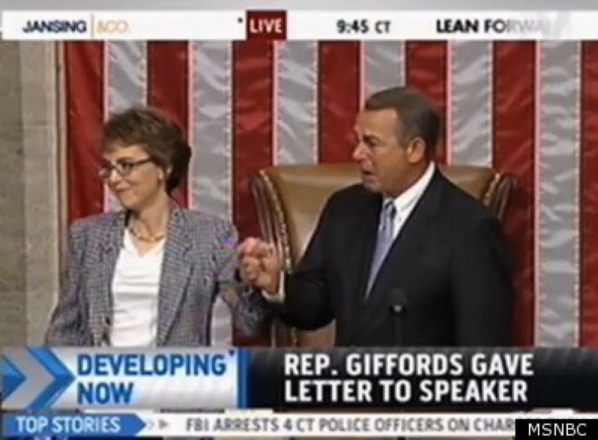 Rep. Gabrielle Giffords (D-Ariz.) and House Speaker John Boehner of Ohio, on the floor of the House on Capitol Hill in Washin
