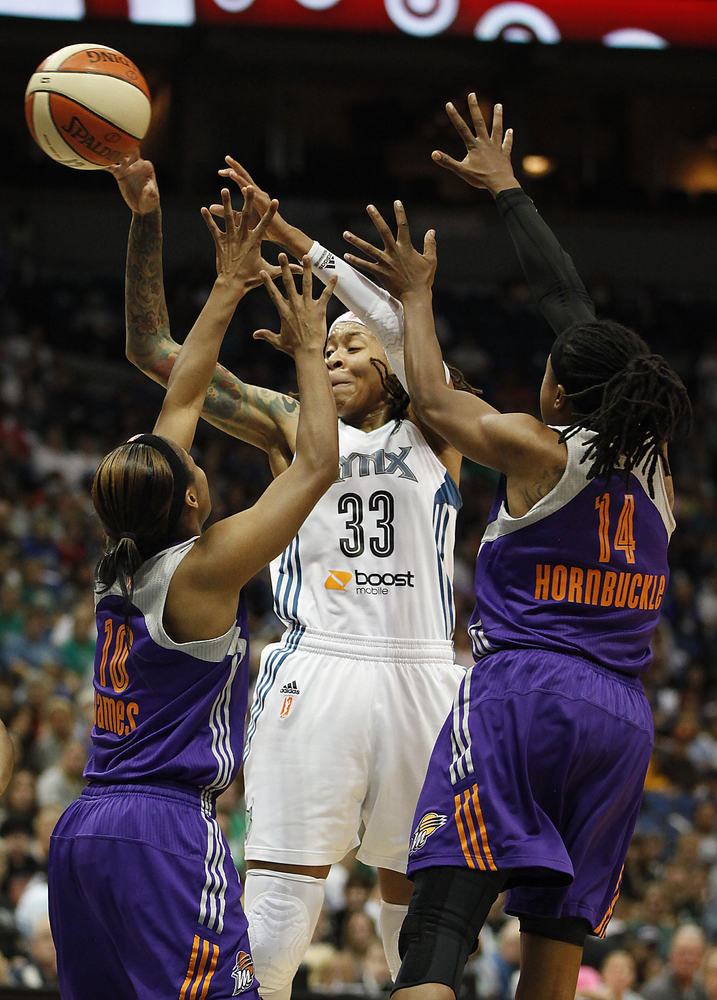 Minnesota Lynx guard Seimone Augustus (33) passes the ball past Phoenix Mercury guard Jasmine James (10) and guard Alexis Hor