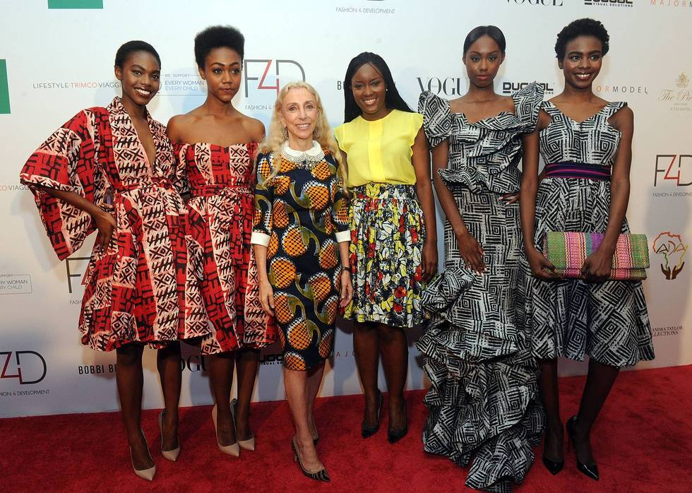 Franca Sozzani, center left, Editor-in-Chief Vogue Italia, and Madam Wokie designer, center right, attend the Fashion 4 Devel