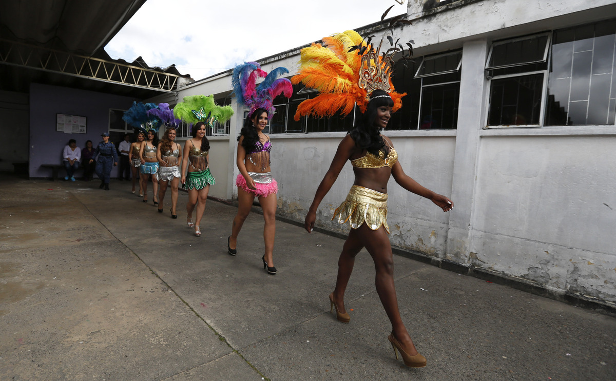 Inmates in costume walk to the stage to participate in a beauty pageant inside El Buen Pastor women's prison in Bogota, Colom