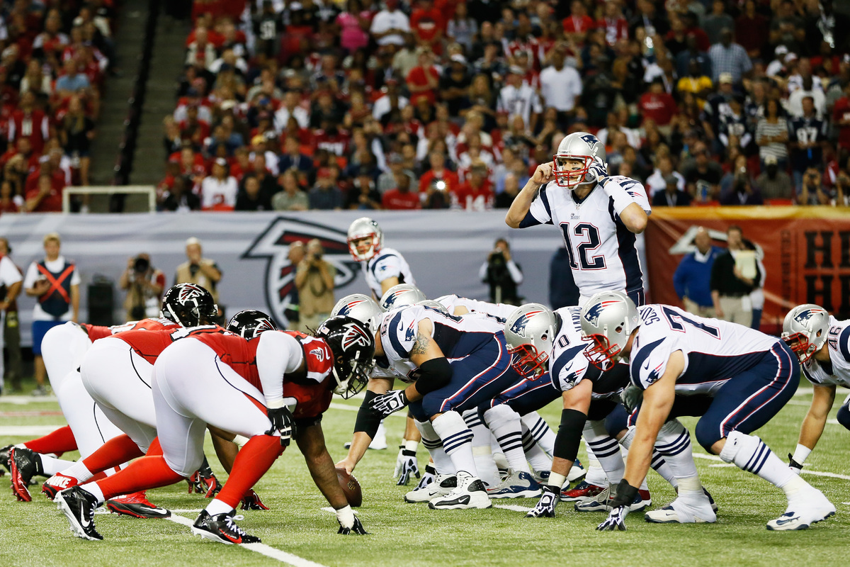 ATLANTA, GA - SEPTEMBER 29:  Tom Brady #12 of the New England Patriots calls a play against the Atlanta Falcons during the ga
