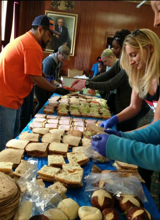 Volunteers gather at the Lawson House YMCA in Chicago to pack lunches during a Hashtag Lunchbag event on Sunday, Sept. 29.