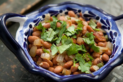 """<strong>Get the <a href=""""http://www.simplyrecipes.com/recipes/pinto_beans_with_bacon_and_jalapenos/"""" target=""""_blank"""">Pinto Be"""