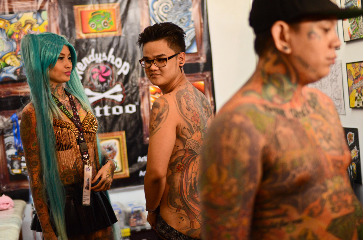 Tattoo enthusiasts take part in the Dutdutan Tattoo Festival on September 28, 2013 in Manila, Philippines. The festival is th